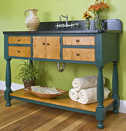"""This Farmhouse Open Style vanity is 50"""" wide and although usually made of poplar this one was custom built with tiger maple accents. This particular vanity has four functional drawers and a removable bottom shelf. The solid wood top and back-splash are optional."""