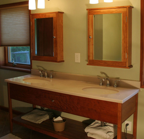 "This open style vanity is 72"" wide, made from solid cherry, with one centered drawer and a manufactured top."