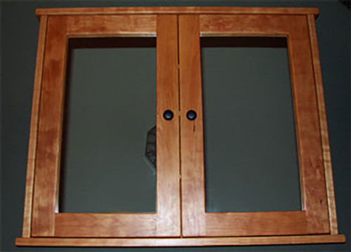 Surface mounted, shaker style, double door medicine cabinet with mirrored doors. Shown in cherry with oil  rubbed bronze hardware. The style is the same for painted.