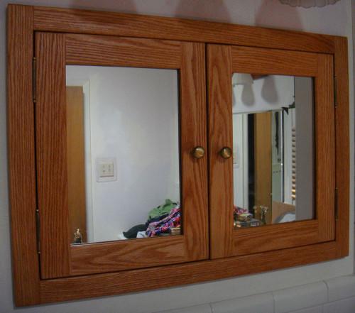 Recessed, shaker style, double door medicine cabinet with mirrored doors. Shown in red oak.