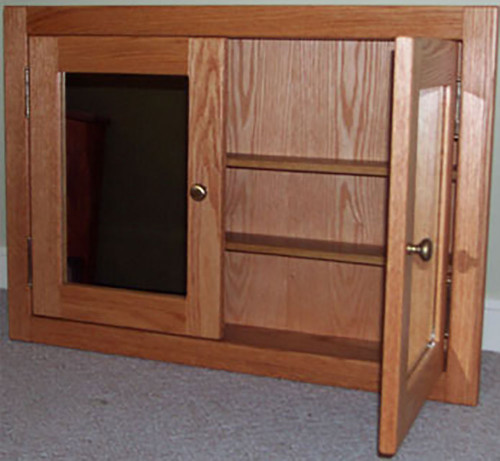 Recessed, shaker style, double door medicine cabinet with mirrored doors. Shown in red oak. The style is the same for painted.