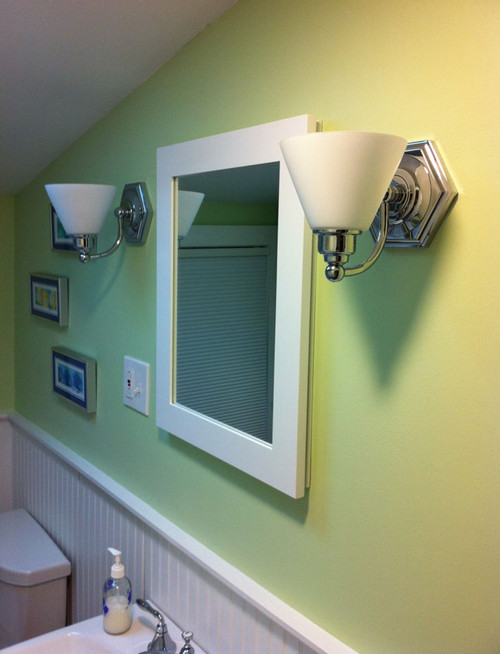 This concealed medicine cabinet was chosen with a non-beveled mirror.  This one is painted white but the style is the same for unfinished.