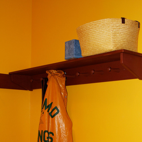 """Shown here painted with barn red milk paint and then lightly distressed, the 5 1/2"""" high peg rack and the 10"""" deep shelf are made from poplar.  The maple pegs are 4-5/8"""" long with a 1-1/4"""" diameter head."""