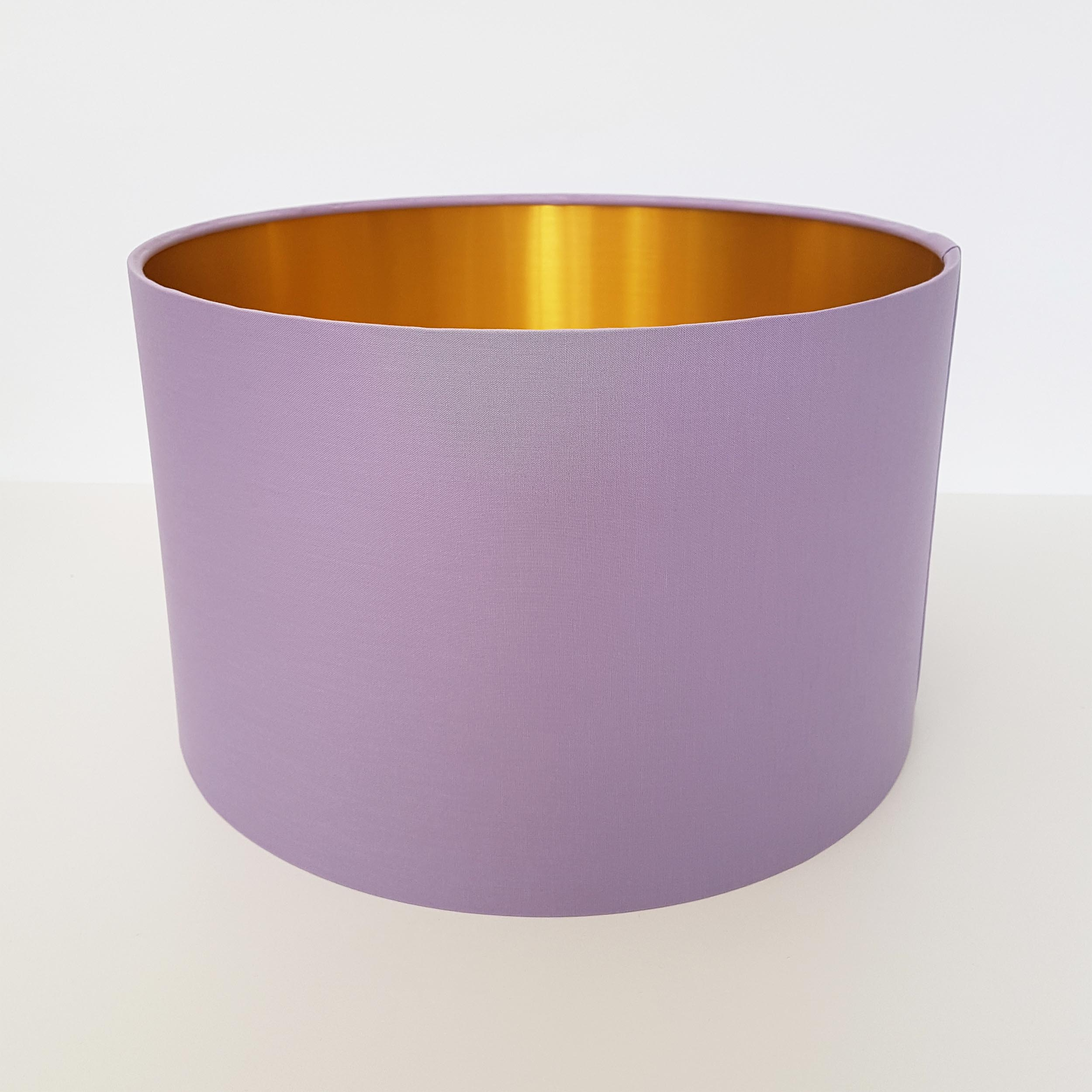 Light purple lampshade with brushed gold lining