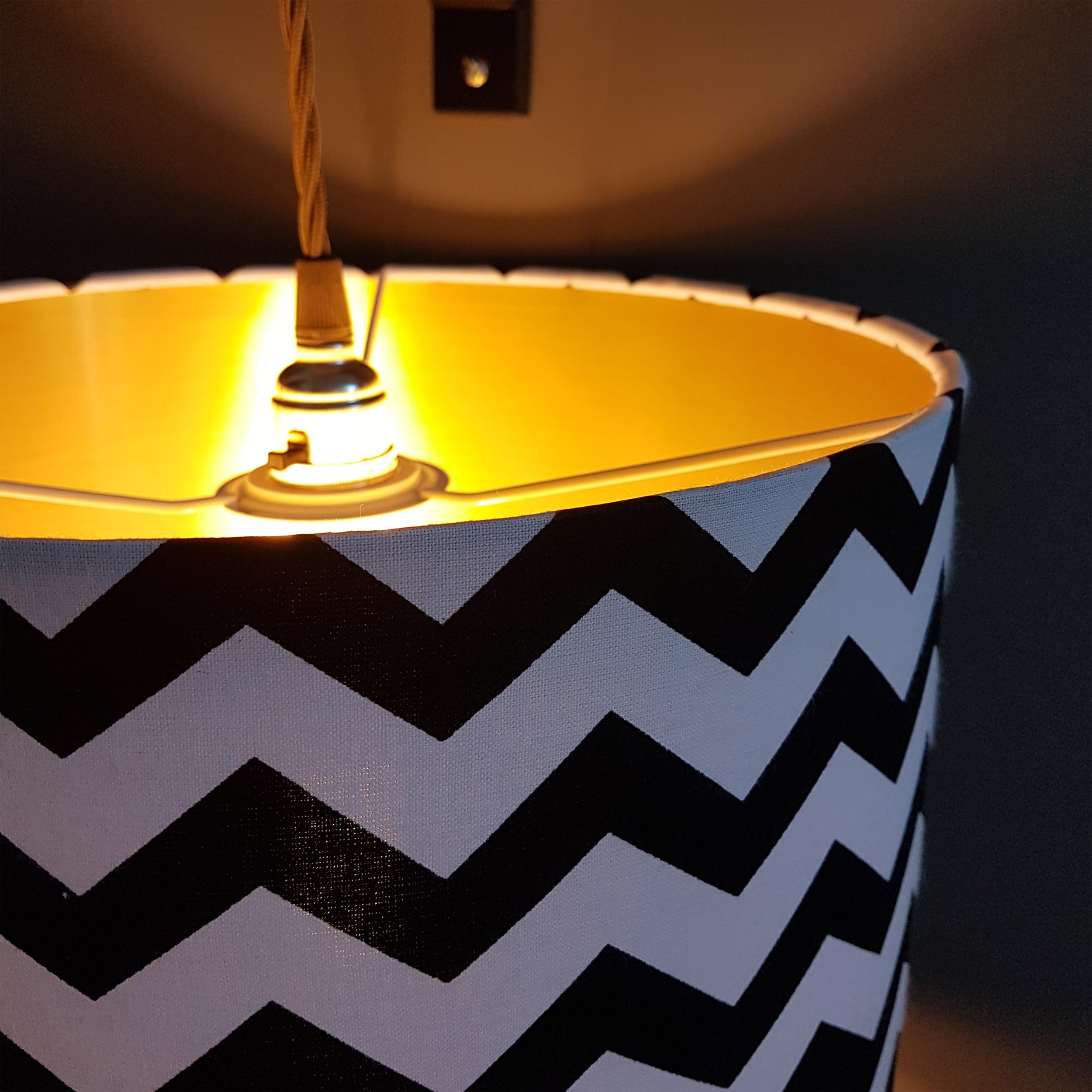 Monochrome Zig Zag lampshade with brushed gold liner