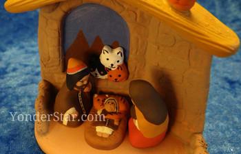 Cat nativity scene closeup