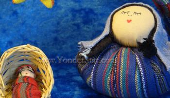 Jesus in basket nativity set.
