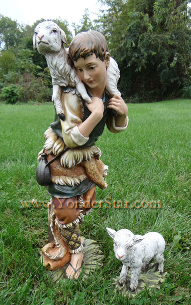 Outdoor nativity shepherd and sheep