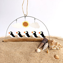 Five puffins hanging decoration.