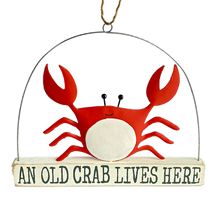 Crab standing on a block that reads 'an old crab lives here'