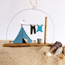 Blue tent camping scene with bird and clothes line