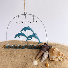 Thee dolphins jumping hanging decoration.