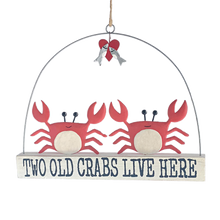 Two Old Crabs standing on a block that reads 'Two old crabs lives here'