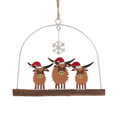 Three Highland Cows on a branch wearing Santa hats