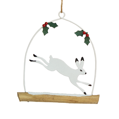 Leaping artic hare on a branch