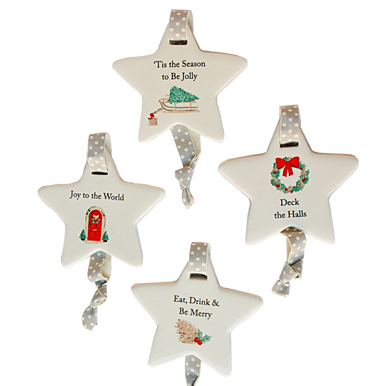Four ceramic star decoration with different cute winter sentiments, little pictures and polka dot hanging ribbon.