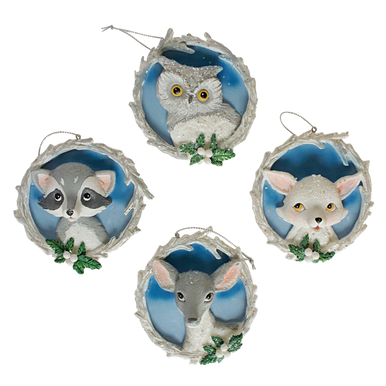 4 Circular Animal head plaque hanging decorations of an owl, a doe, a raccoon and an artic fox, each surrounded by a circular white branch and on a dark blue background.