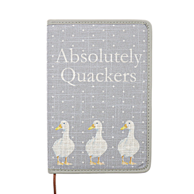 'Absolutely Quackers' design covered notebook with 3  ducks on a grey background with white dots.