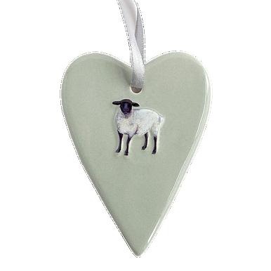 Ceramic duck egg grey heart with a little sheep motif.