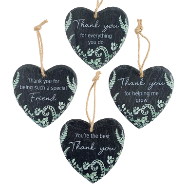 Four slate hearts with different thank you sentiments printed on them.