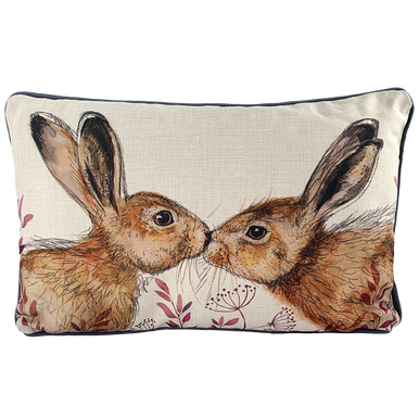 Two illustrated hares kissing on a cushion