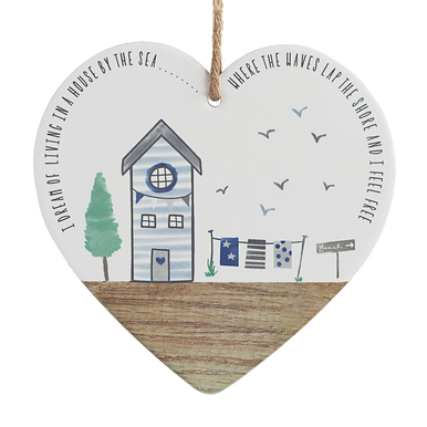 Ceramic Heart beautifully decorated with an illustration of a beach scene and sentimental wording around it.