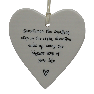 """Beautiful heart shaped hanging ceramic decoration with the wording """"Sometimes the smallest step in the right direction end up being the biggest step of your life"""" printed in an illustrative handwriting with a little heart detail."""
