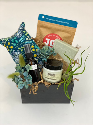 small gift crate with candle, chocolates, eyepillow, soap, airplant