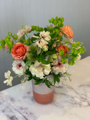 In a bit of a taller ceramic vase, rose gold/blush in color, we combine lush yet simple flowers in pastel tones.