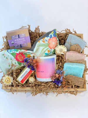 Sweeten the Senses gift crate with Cancelled Plans candle, lavender and flaxseed relaxing eye pillow, Fran's chocolates, handmade soap bars, and dried flower blooms