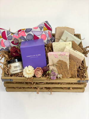 custom gift crate with lavender flaxseed eye pillow, candles, handmade soaps and fresh flower blooms
