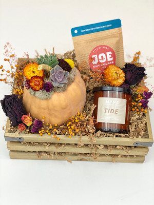 Specialty items include a decorated pumpkin (REAL PUMPKIN) with dried botanicals and succulent attached, fragrant MYNE Company candle, and a package of Joe's salted caramel chocolates