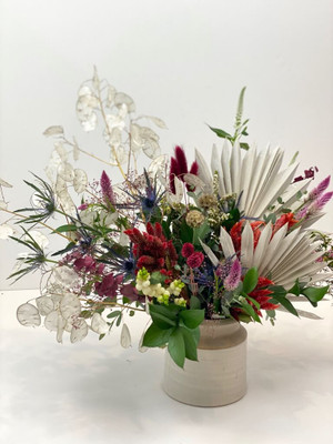 Textural dried artistic elements with fresh blooms and greenery