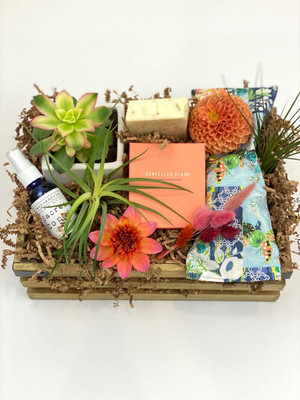 coral toned flowers candle cancelled plans gift crate
