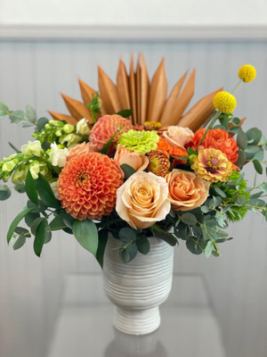 dried coral palm leaf coral dahlias white roses white hydrangea funky vase