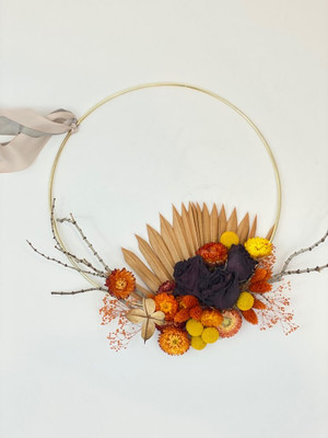 gold hoop with everlasting dried florals in tones of bordeaux, coral, sienna, peach and yellow