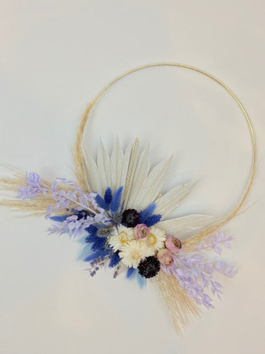 gold hoop with everlasting dried florals in tones of blue, lavender, white and cream