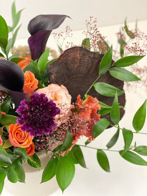 In this design we pair fresh flowers with textural and dried mushrooms, seasonal foliage and finish in a ceramic pot.