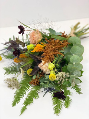 Seasonal flowers are gathered, tied with raffia and wrapped in paper. Flower stems stay hydrated with an eco-wrap