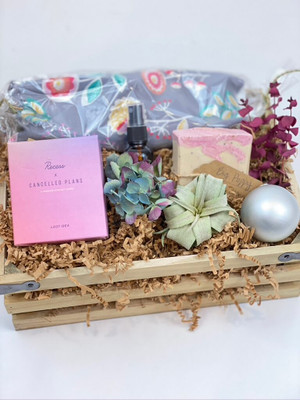 Dusty pink gift crate cancelled plans candle, air plant and mister, handmade soap, dried flowers, holiday ornament for seattle flower delivery
