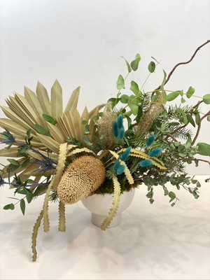 We combine dried and artificial botanicals and flowers in a luxury container. This particular floral is designed for an entryway credenza or corner accent table as it is 3 sided. Wembley for seattle flower delivery by juniper flowers
