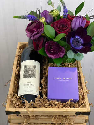 Cozy bear cub gift crate. Kyle MacLachlan, Owner of Pursued By Bear Wines came back to his home state of Washington to make wine. We've chosen 2 of his lovely reds as an option in this crate. Also included is one of our signature 'lil cutie' florals and a Cancelled Plans candle called 'Extrovert'.
