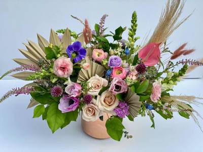 This is a grand statement full of spring blooms! Lots to look at here with varying textures and tones. Make an impact with this lush floral complete with pampas grass and dried bunny tail! Seattle flower delivery by Juniper Flowers