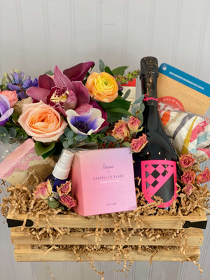 Celebrate gift crate. This luxe gift crate is made with a desktop floral, handmade soap, refreshing hydrosol mist, candle, eye pillow, chocolates and a bottle of your choice of wine or champagne. Fun for a special occasion! Seattle flower delivery by Juniper Flowers