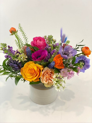 Our favorite pottery vase filled with vivid spring blooms including hyacinth, stock, anemone, ranunculus and bunny tail. These signs of spring will carry over for the next month or so keeping our days brighter. Perfect for any occasion. Seattle flower delivery by Juniper Flowers