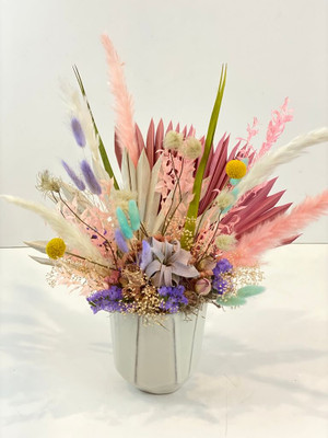 Dried flowers in spring pastel tones include pampas grass, bunny tail and fan palms in a decorative ceramic pot for Seattle flower delivery by Juniper Flowers