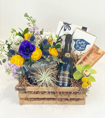 Graduation gift crate Seasonal floral, half bottle of Roederer Estate Champagne, airplant and water mister, Dahlia Press notepad and letterpress card, Fran's Chocolates, fresh and dried flower blooms. Seattle flower delivery by Juniper Flowers