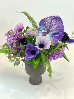 Birth Month Floral - JUNE We play with paint! June actually has 3 birthstones but we chose to showcase the Alexandrite in all it's glory. The focal anthurium flower takes on an iridescent quality with an artistic painted sheen. Seattle flower delivery by Juniper Flowers