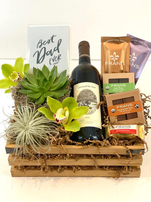 Father's Day Gift Crate Celebrate Dads with a fun gift crate of high end Cabernet Sauvignon from Pursued By Bear winery in Walla Walla, WA. Accenting items are a succulent plant and long lasting air plant, a collection of Fran's Chocolates, fresh orchid blooms and letterpress card from Dahlia Press. Seattle flower delivery by Juniper Flowers