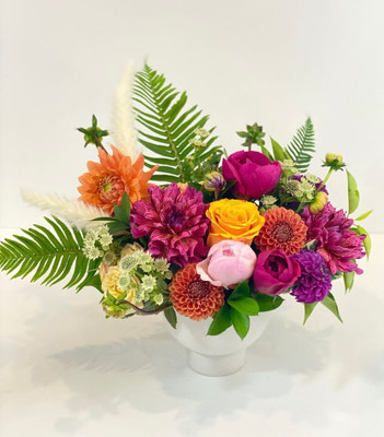BFF Summer Favorite Take two of the best flowers: dahlias and peonies, put them with greenery and accent flowers in a white ceramic compote vase and you've got a best friend forever or at least for the summer! Seattle flower delivery by Juniper Flowers